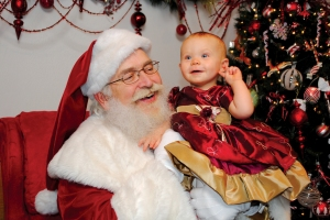 child-with-santa-at-santa-claus-christmas-store